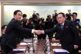 Head of the North Korean delegation, Ri Son Gwon shakes hands with South Korean counterpart Cho Myoung-gyon as they exchange documents after their meeting at the truce village of Panmunjom in the demilitarized zone separating the two Koreas, South Korea.