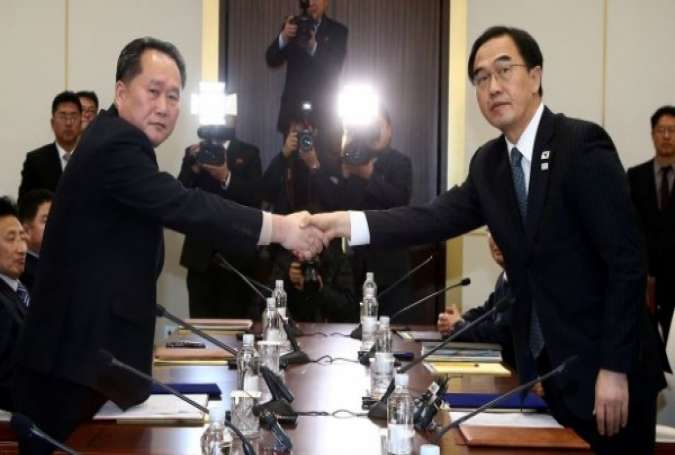 North, South Korea delegations discuss Olympic Games in truce village