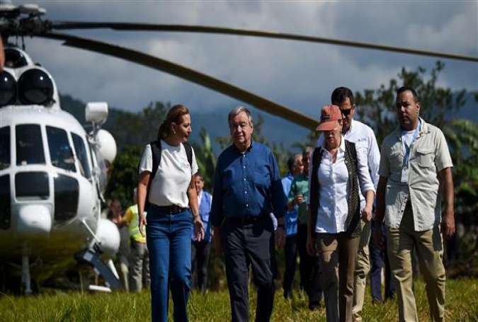 "UN Secretary-General Antonio Guterres (C) arrives at the Buenavista ""Territorial Area for Training and Reinstatement of FARC"" in the Mesetas municipality, Meta department, Colombia on January 14, 2018. (Photo by AFP)"