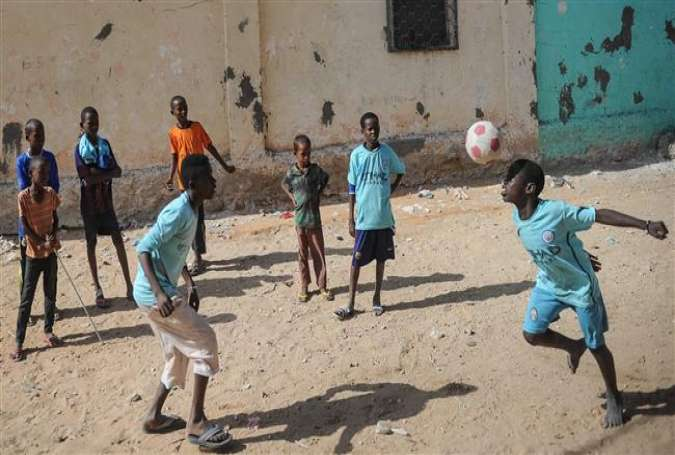 Somali children play football on a street in Mogadishu on January 12, 2018. (Photo by AFP)