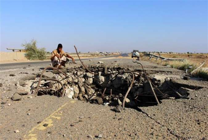 A Yemeni man inspects the damage made by a Saudi airstrike on a bridge between the area of Abbas and Harad in the northern province of Hajjah, on December 25, 2017. (Photo by AFP)