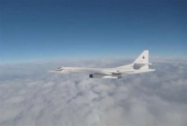 This video grab released by the UK Ministry of Defense shows a Russian Tu-160 bomber flying near British airspace over the North Sea.