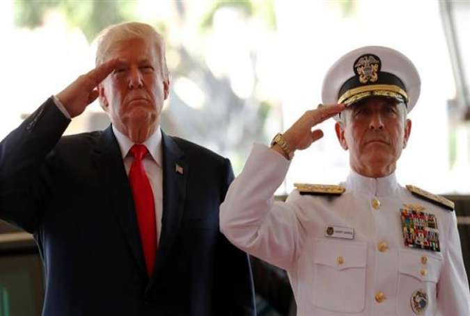In this file photo, US President Donald Trump is welcomed by US Navy Admiral Harry Harris, commander of US Pacific Command, at its headquarters in Aiea, Hawaii, November 3, 2017. (Photo by Reuters)