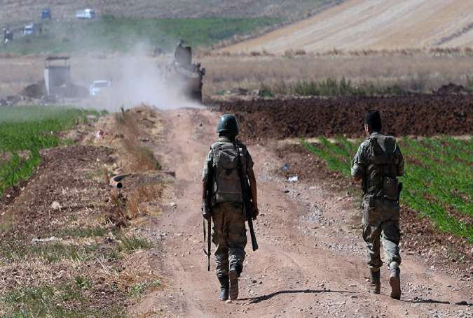 Turkish soldiers patrolling near Syria border.jpg