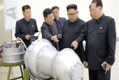 Kim Jong-un - North Korean leader looking at a metal casing with two bulges at an undisclosed location..jpg