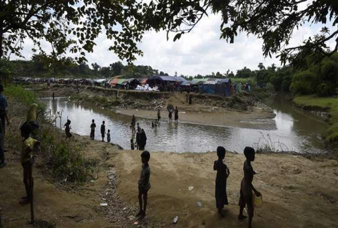In this photograph taken on September 16, 2017, Rohingya Muslim refugees look on at the Jalpatoli refugee camp, in the no-man