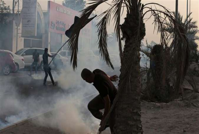 Bahraini protesters clash with riot police during a demonstration in Daih village, Bahrain.jpg
