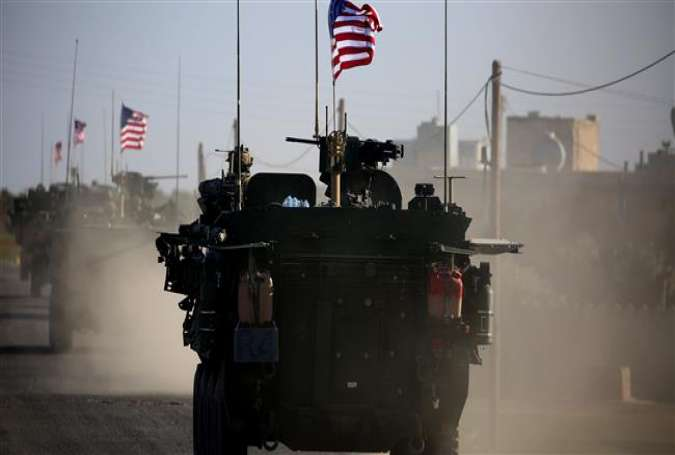 The photo, taken on March 5, 2017, shows a convoy of US armored vehicles driving near the village of Yalanli, on the outskirts of the northern Syrian city of Manbij. (By AFP)