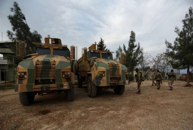 Turkish-backed Free Syrian Army fighters are seen next to military trucks in Northern Afrin countryside, Syria, February 16, 2018