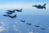 This handout picture, taken and released by the South Korean Defense Ministry in Seoul on December 6, 2017, shows a US Air Force B-1B Lancer bomber (L), two US F-35As, and two US F-35B stealth jets (far) flying over South Korea. (Via AFP)