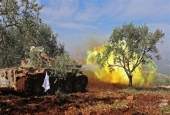Turkish-backed militants fire from the town of Salwah.jpg