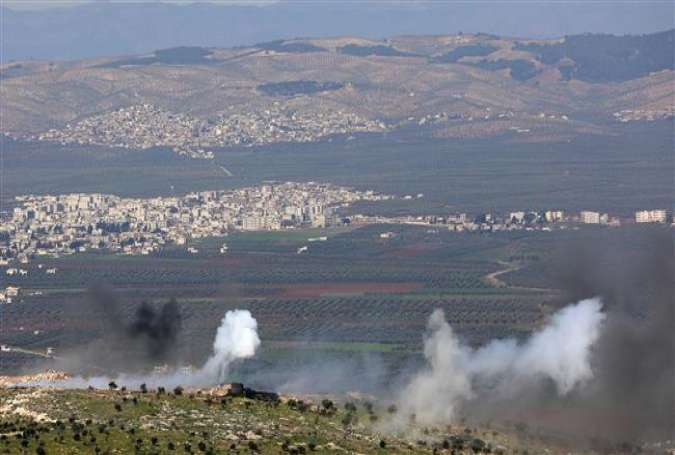 Turkish-backed Syrian rebel fighters fire towards Kurdish forces from the People