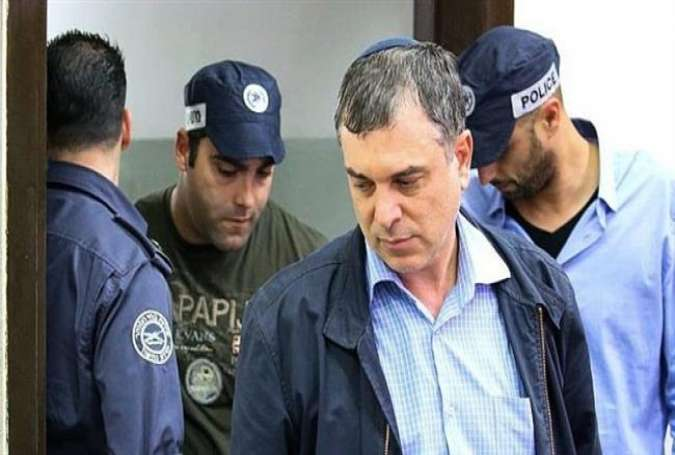 This photo taken from Israeli media shows Israeli Prime Minister Benjamin Netanyahu's confidante, Shlomo Filber, arriving for a hearing at the Rishon Lezion Magistrate's Court on February 18, 2018.