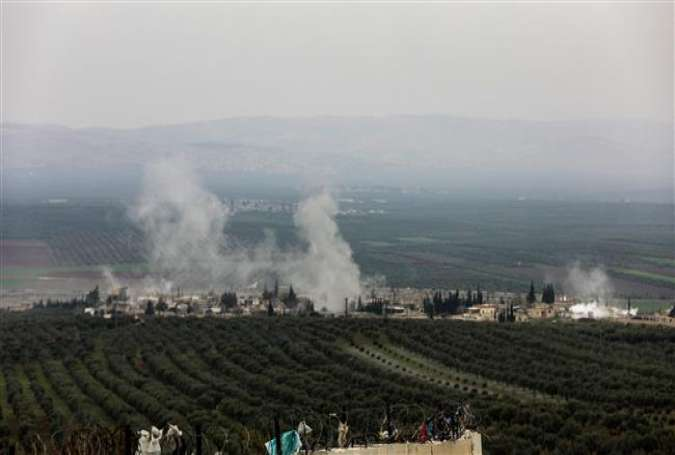 A picture taken on February 10, 2018 from the Syrian village of Atme in the northwestern province of Idlib shows smoke plumes rising in the village of Deir Ballut in the Afrin region, where Turkish forces and allied militants are conducting an offensive. (Photo by AFP)