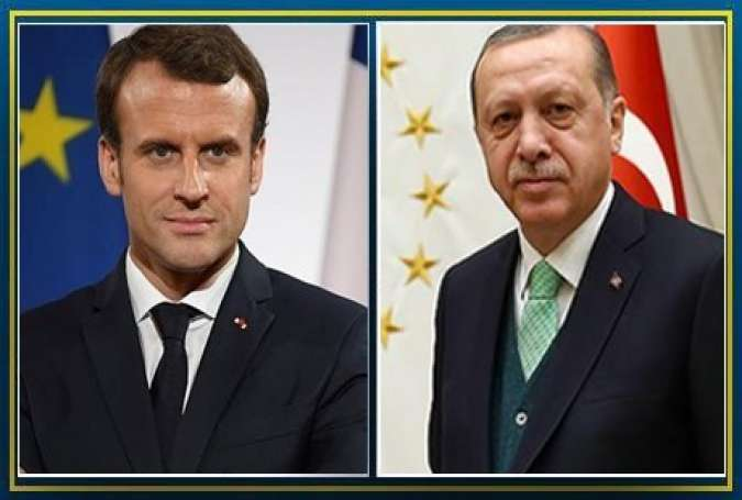 Turkish President Recep Tayyip Erdogan and his French counterpart Emmanuel Macron.jpg