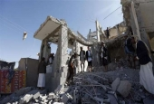 Yemenis check the damage in the aftermath of a reported airstrike in the Yemeni capital Sana