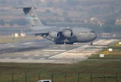 A US air force cargo plane maneuvers on the runway after it landed at Incirlik Air Base, on the outskirts of the city of Adana, southern Turkey, Friday, July 31, 2015