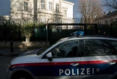 Austrian police car drives outside of the Iran ambassador
