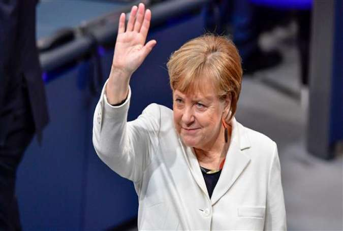 German Chancellor Angela Merkel waves as she arrives to attend the session for the election of the German Chancellor at the Bundestag (lower house of parliament), in Berlin, on March 14, 2018. (Photo by AFP)