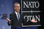 NATO Secretary-General Jens Stoltenberg gestures as he addresses a press conference to give the alliance