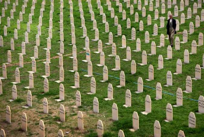 Graphic content / (FILES) In this file photo taken on March 16, 2014 an Iraqi Kurd man walks past grave stones as he visits a grave yard for the victims of a gas attack by former Iraqi president Saddam Hussein in 1988 in the Kurdish town of Halabja, 300 kms (190 miles) northeast of Baghdad. (AFP photo)