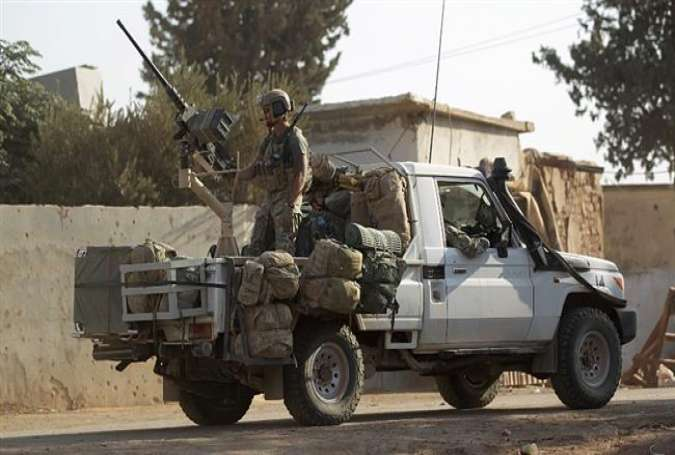 US soldiers ride a military vehicle in al-Kherbeh village, northern Aleppo Province, Syria.jpg