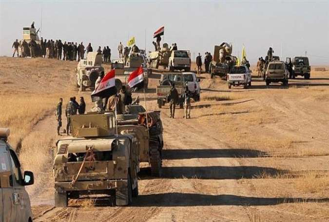 Iraqi forces, supported by members of the Hashed al-Shaabi (Popular Mobilization Units).jpg