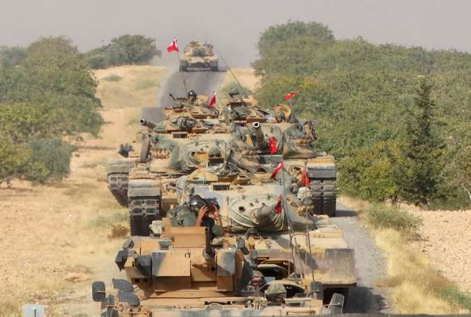 Turkish army tanks make their way towards the Syrian border town of Jarablus, Syria.jpg