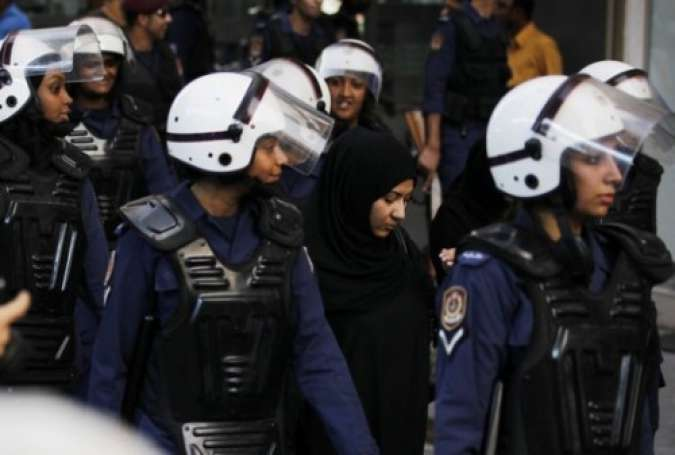 Bahraini forces arresting a female activist