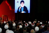 Lebanon's Hezbollah chief Sayyed Hassan Nasrallah is seen on a video screen during an address in Beirut, February 16, 2018.