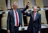 Outgoing Cuban President Raul Castro (R) raises the arm of Cuba's new President Miguel Diaz-Canel after he was formally named by the National Assembly, in Havana, on April 19, 2018. (Photo by AFP)