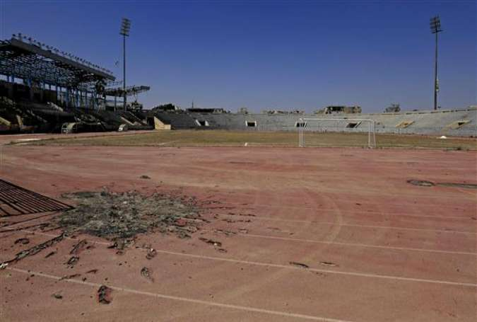 A shrapnel-riddled track is seen during a football match between local teams al-Sadd and Rashid at a stadium in the northern Syrian city of Raqqah, April 16, 2018. (Photo by AFP)