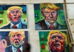 Paintings of US President Donald Trump by Kenyan artist Evans Yegon. (Photo by AFP)
