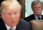 US President Donald Trump speaks alongside National Security Adviser John Bolton (R) during a Cabinet Meeting in the Cabinet Room of the White House in Washington, DC, May 9, 2018. (Photo by AFP)