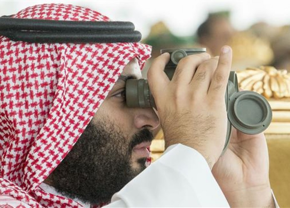 "The handout provided by the Saudi Royal Palace on April 16, 2018, shows Crown Prince Mohammed bin Salman using binoculars to follow the ""Persian Gulf Shield 1"" military drills at their closing ceremony in the eastern Saudi region of Dhahran, on the sidelines of the 29th Arab League summit. (Photo via AFP)"