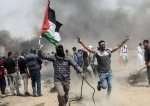 Palestinian protesters clash with Israeli forces