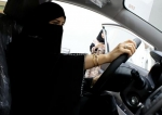 Saudi woman checks a car at the first automotive showroom.jpg