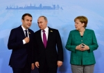 French President Emmanuel Macron, Russian President Vladimir Putin and German Chancellor Angela Merkel.jpg