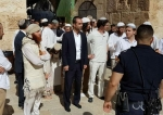 Israeli settlers, backed by IOF, while stroming Al-Aqsa Mosque