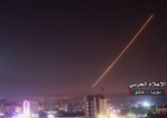 "An image released on May 10, 2018 by the government-affiliated ""Central War Media"" in Syria shows Syrian air defense systems intercepting Israeli missiles over Damascus. (Via AFP)"