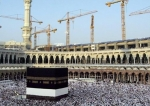 This photo shows cranes in the background at construction sites behind Mecca