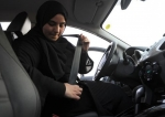 Saudi woman puts on her seatbelt during a driving lesson in the port city of Jeddah.jpg
