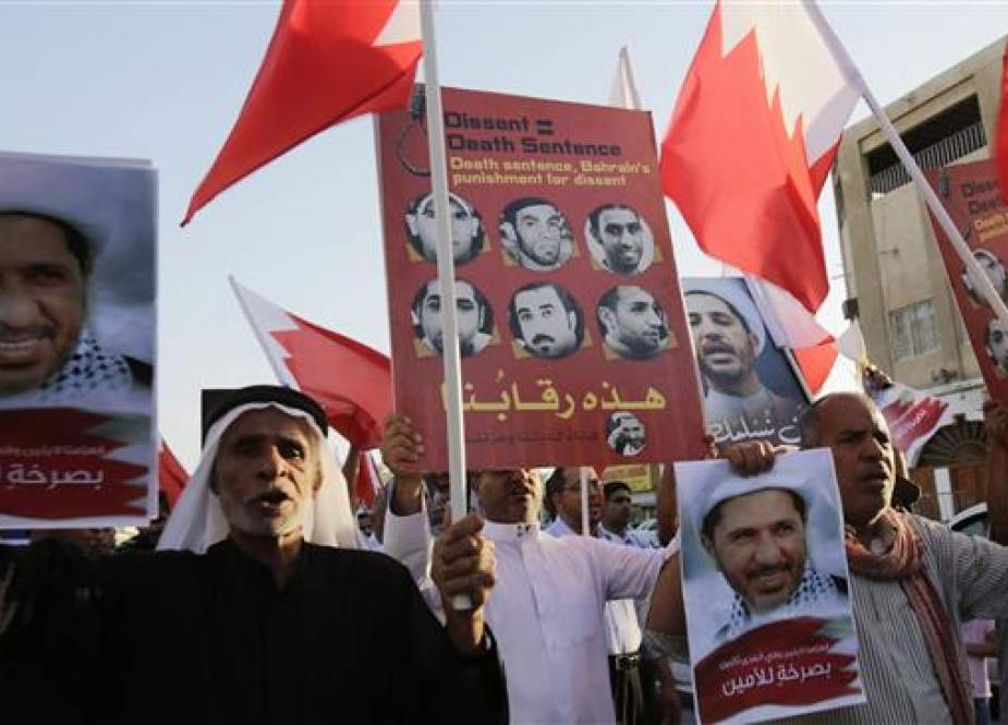 Bahraini protesters hold up images of jailed Shia opposition leader Sheikh Ali Salman and other protesters sentenced to death as they chant slogans demanding their freedom during a protest in Daih, March 3, 2015. (Photo by AP)