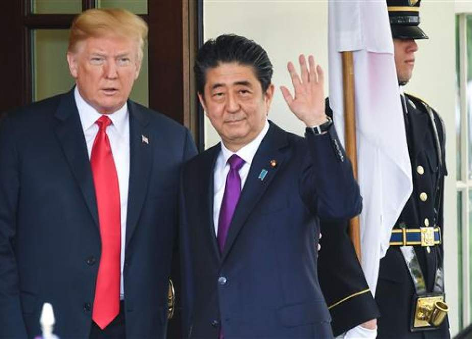 US President Donald Trump greets Japanese Prime Minister Shinzo Abe at the White House