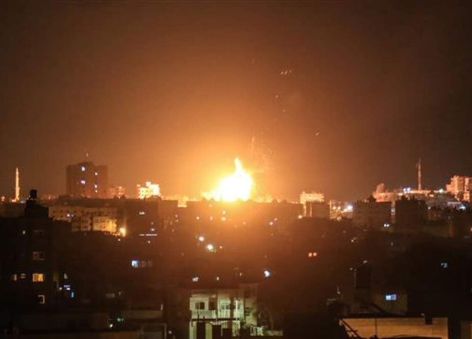An explosion is seen in northern Gaza City after an airstrike by Israeli jets on June 20, 2018. (Photo by AFP)