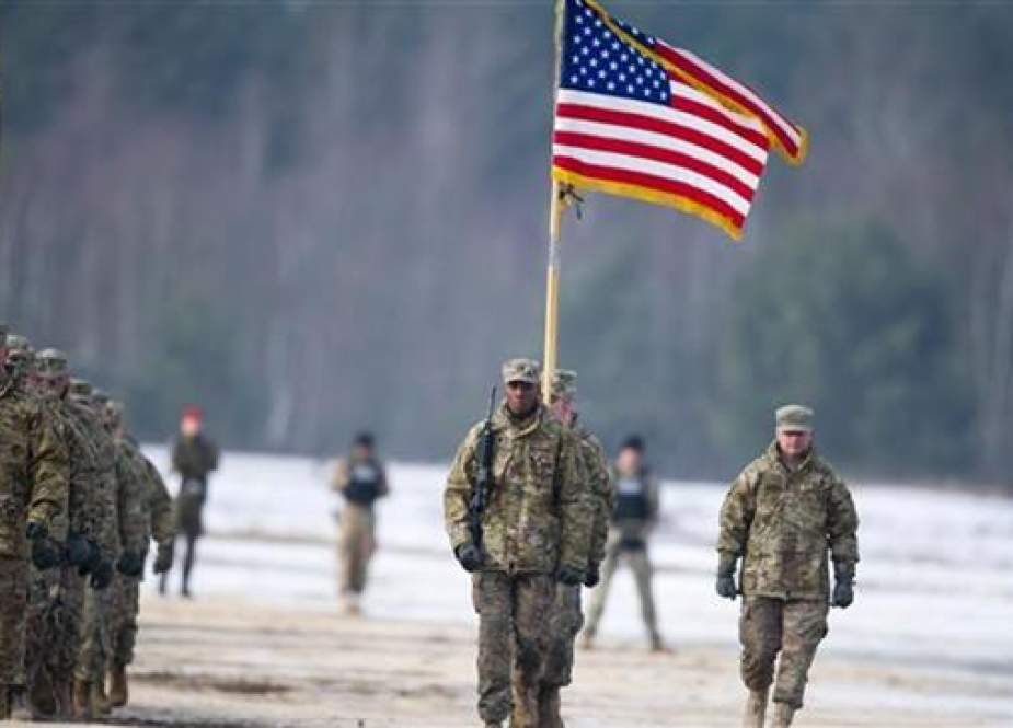 US soldiers march with their flag during a welcome of the US Army's 3rd Armored Brigade Combat Team for a joint military training of US and Polish forces in support of Operation Atlantic Resolve in Zagan, Poland, January 30, 2017. (Photo by AFP)