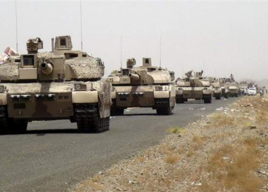 Saudi tanks are seen on a road leading to the al-Anad airbase in the country