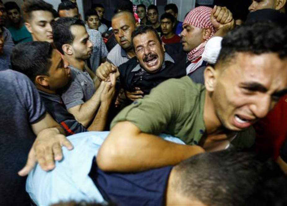 Palestinian relatives react as they arrive at the morgue of the al-Shifa hospital in Gaza City