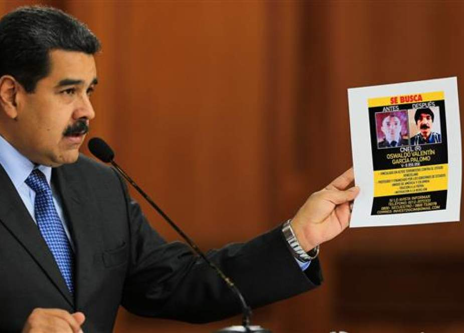 A handout picture released by the Venezuelan presidency shows Venezuelan President Nicolas Maduro speaking during the broadcasting of a television program, at the Miraflores presidential palace in Caracas, on August 7, 2018. (Via AFP)