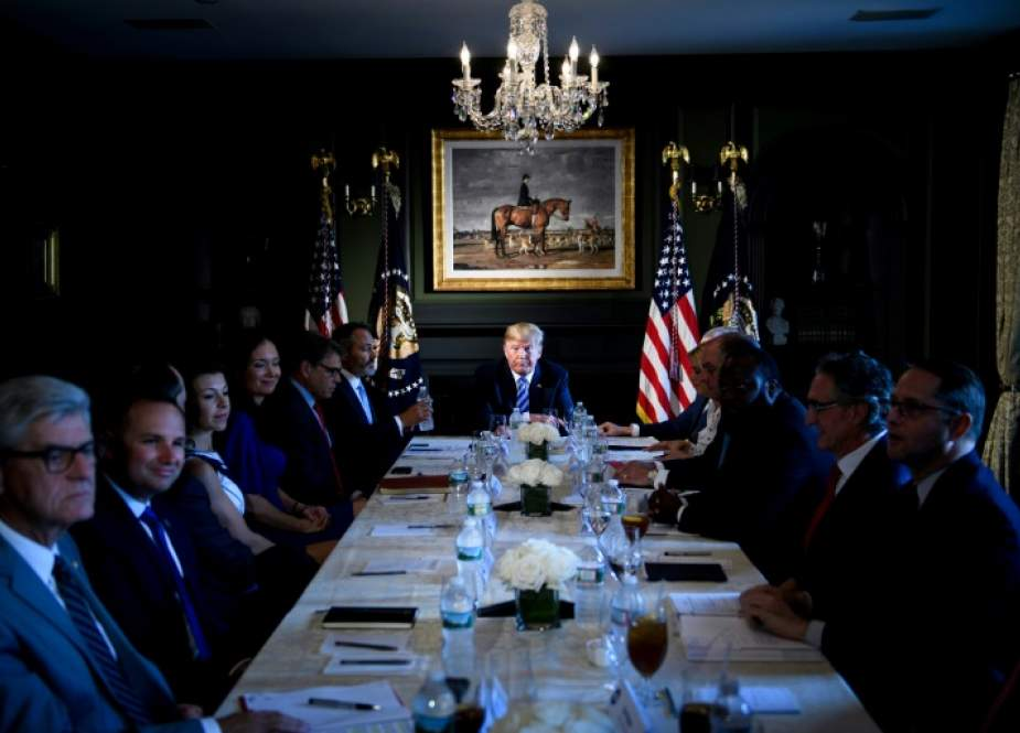 US President Donald Trump chairs a meeting with administration and state officials on prison reform at the Trump National Golf Club August 9, 2018 in Bedminster, New Jersey. (AFP photo)